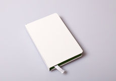 Notepad blank cover on white table Royalty Free Stock Image