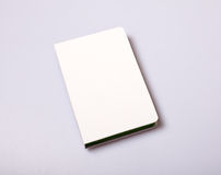 Notepad blank cover on white table Stock Image