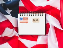 Notepad with blank page, US Flag stock photo