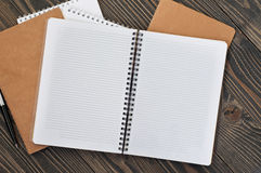 Notepad with blank pages and pen Royalty Free Stock Images