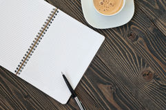 Notepad with blank pages, pen and coffee Stock Photos