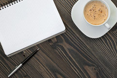 Notepad with blank pages, pen and cup of coffee Royalty Free Stock Photography