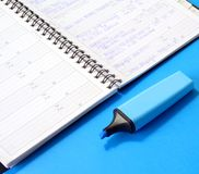 Notepad and blue marker Stock Images
