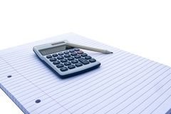 Notepad with blue and white calculator with with solar power and pencil for accounts, business, education etc. On white background royalty free stock image