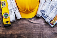 Notepad blueprints hard hat wooden meter and Stock Photo