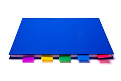 Notepad with bookmarks. Blue notepad with colorfull bookmarks on white background Royalty Free Stock Image