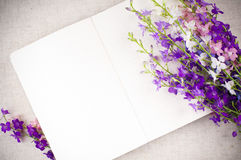 Notepad and a bouquet Stock Photography