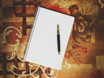 Notepad on a bright colored. Tablecloths Royalty Free Stock Photography
