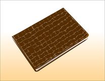Notepad with a brown cover made of leather, similar to crocodile. Royalty Free Stock Photography