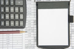 Notepad and brown pencil with calculator on finance account. As background stock photography