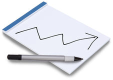 Notepad with business graph arrow up. Notepad isolated with handwritten business graph arrow pointing up on a white sheet of paper with blue binding and a pen Royalty Free Stock Image