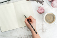 Notepad, cakes and coffee, romantic Royalty Free Stock Photo