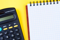 Notepad and calculator. Stock Image