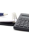 Notepad and calculator Stock Photos