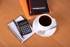 Notepad, calculator and cup of coffe Royalty Free Stock Photo