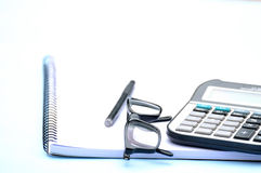 Notepad calculator pen eyeglass Royalty Free Stock Image