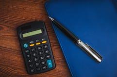 Notepad with calculator Stock Photos