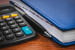 Notepad with calculator Royalty Free Stock Photos