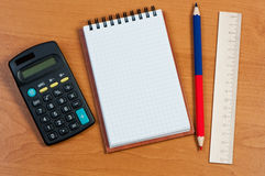 Notepad, calculator and pencil on table. Royalty Free Stock Photography
