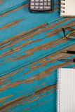 Notepad, calculator, pens and spectacles Royalty Free Stock Image