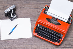Notepad and camera Royalty Free Stock Images