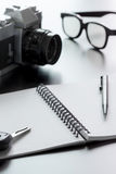 Notepad camera and pen Royalty Free Stock Images