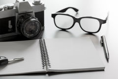 Notepad camera and pen Stock Photography