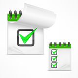Notepad with check mark Royalty Free Stock Photos