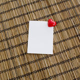 Notepad with clip of heart shape with red color on wood backgrou Stock Photo