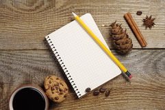 Notepad and coffee with cookies Stock Image