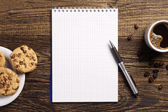 Notepad and coffee with cookies Royalty Free Stock Photo