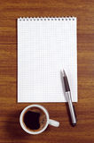 Notepad and coffee cup Royalty Free Stock Photo