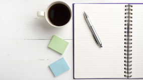 Notepad and coffee cup Stock Photography
