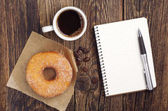 Notepad and coffee with donut Royalty Free Stock Photos