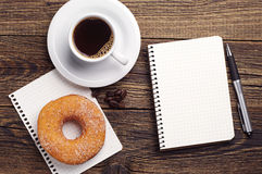 Notepad and coffee with donut Royalty Free Stock Photography