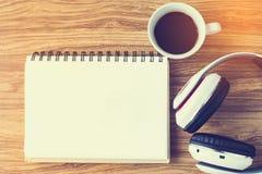 Notepad with coffee mug and headphone Royalty Free Stock Photos