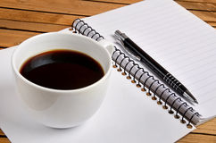 Notepad with coffee Stock Photo