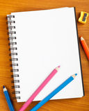 Notepad with color pencils Stock Photos