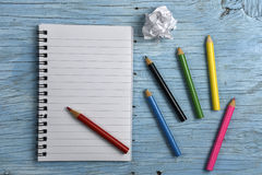 Notepad with colored pencils Stock Image