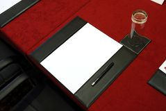 Notepad on a conference table. Stock Photo