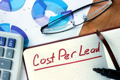 Notepad with Cost per lead CPL on office  table. Royalty Free Stock Photo