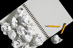 Notepad and crumpled paper balls Stock Images
