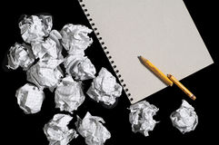 Notepad and crumpled paper balls Royalty Free Stock Photography
