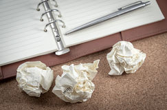 A notepad and crushed paper. For an abstract concept of thinking Stock Images