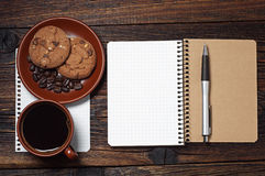 Notepad and cup of coffee Royalty Free Stock Photography