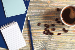 Notepad and cup of coffee Stock Photography
