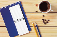 Notepad and cup of coffee Royalty Free Stock Photo