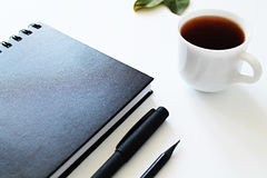 Notepad and cup of tea Stock Photos
