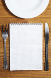 Notepad and cutlery Stock Photos