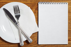 Notepad and cutlery Royalty Free Stock Image